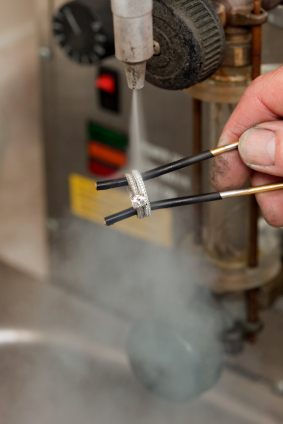 jeweler cleaning ring