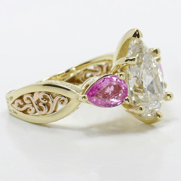 hand engraved three stone pink sapphire ring pear diamond