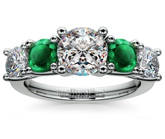 diamond and emerald gemstone engagement ring in platinum