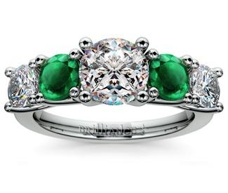 diamond and emerald gemstone engagement ring in platinum