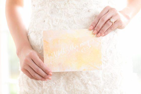 bride holding invite