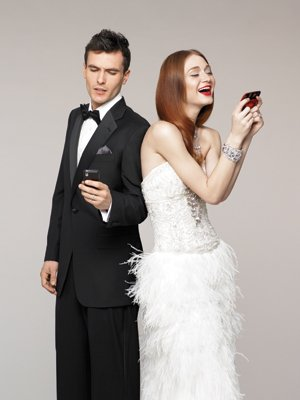bride and groom on cell phones