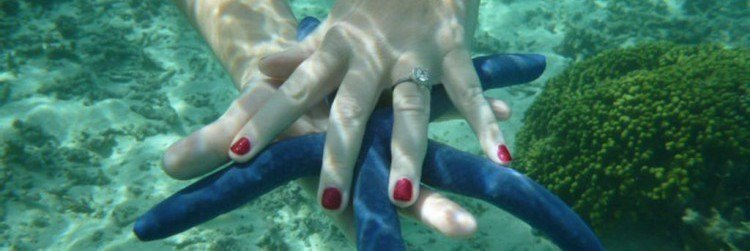 Ring in hand underwater