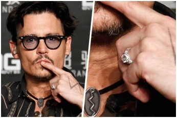Johnny Depp shows his men's engagement ring on the red carpet