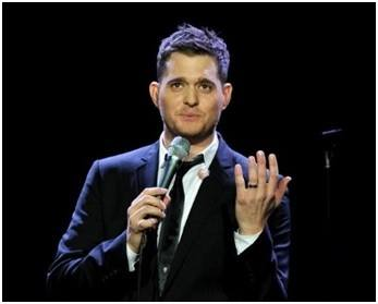 Michael Buble shows his men's engagement ring on stage