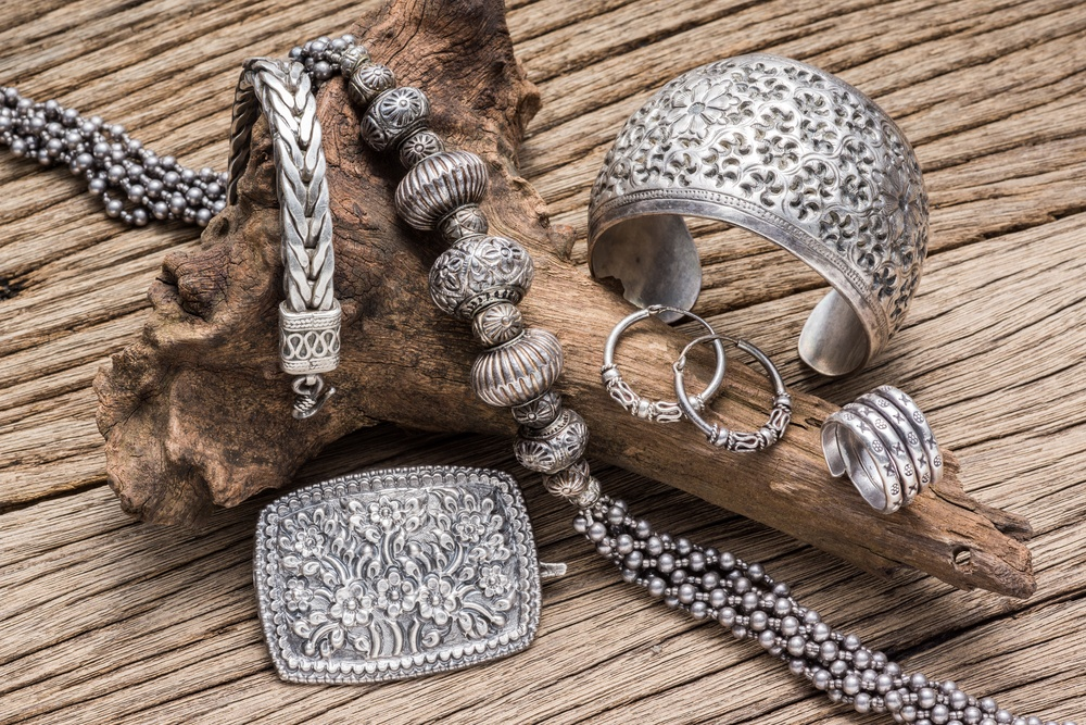 A collection of antique silver jewelry