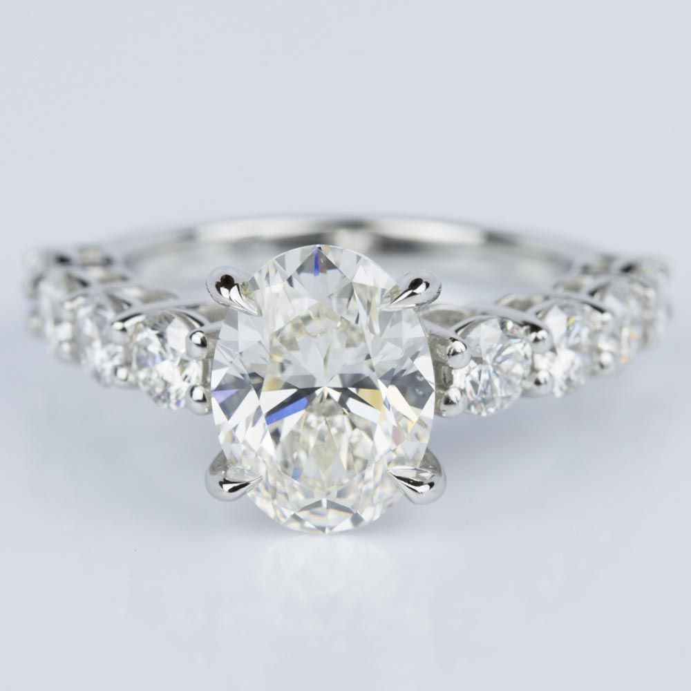 Shared Prong Engagement Ring with Oval Cut Center Diamond