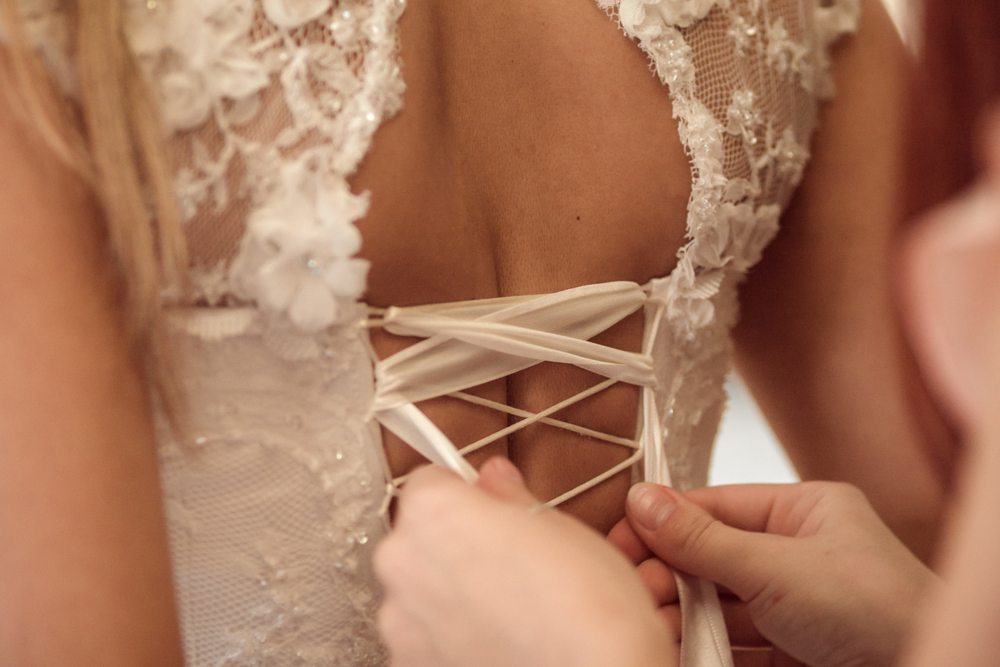 lace-oneself-up-corset-on-white-wedding-dress-close-up