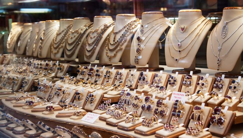 counter-with-variety-of-jewelry-in-store-window