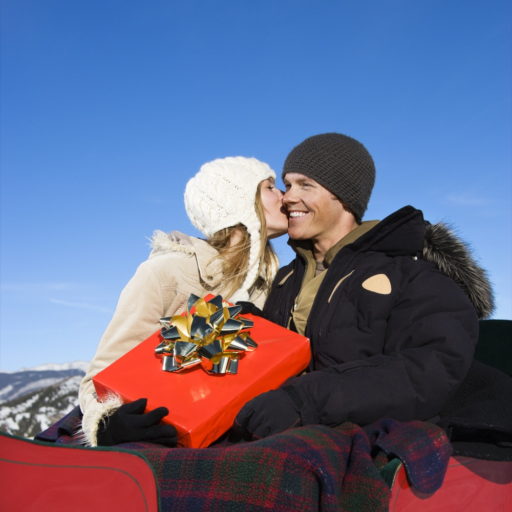 mid adult caucasian couple taking a sleigh ride