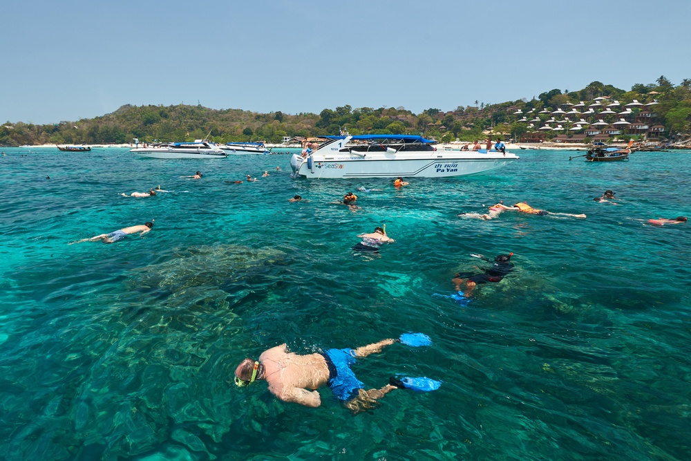 phi-phithailand-march-18-2016-tourists-swimming-and-snorkeling-in-andaman-sea-at-phi-phi-islands-thailand