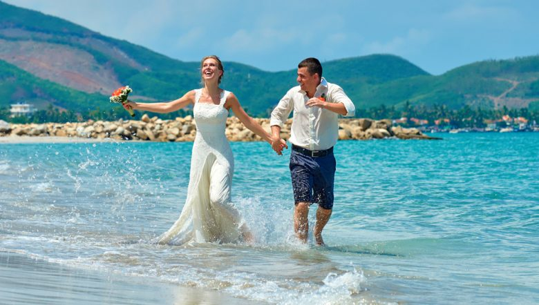 re-happy-bride-and-groom-running-on-a-beautiful-tropical-sand-beach