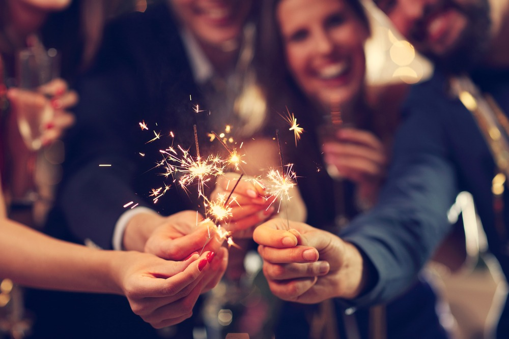 showing group of friends having fun with sparklers