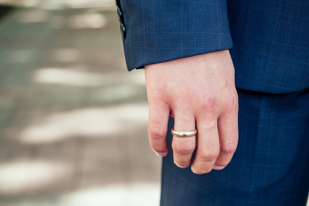 Man wears one of the best men's wedding bands