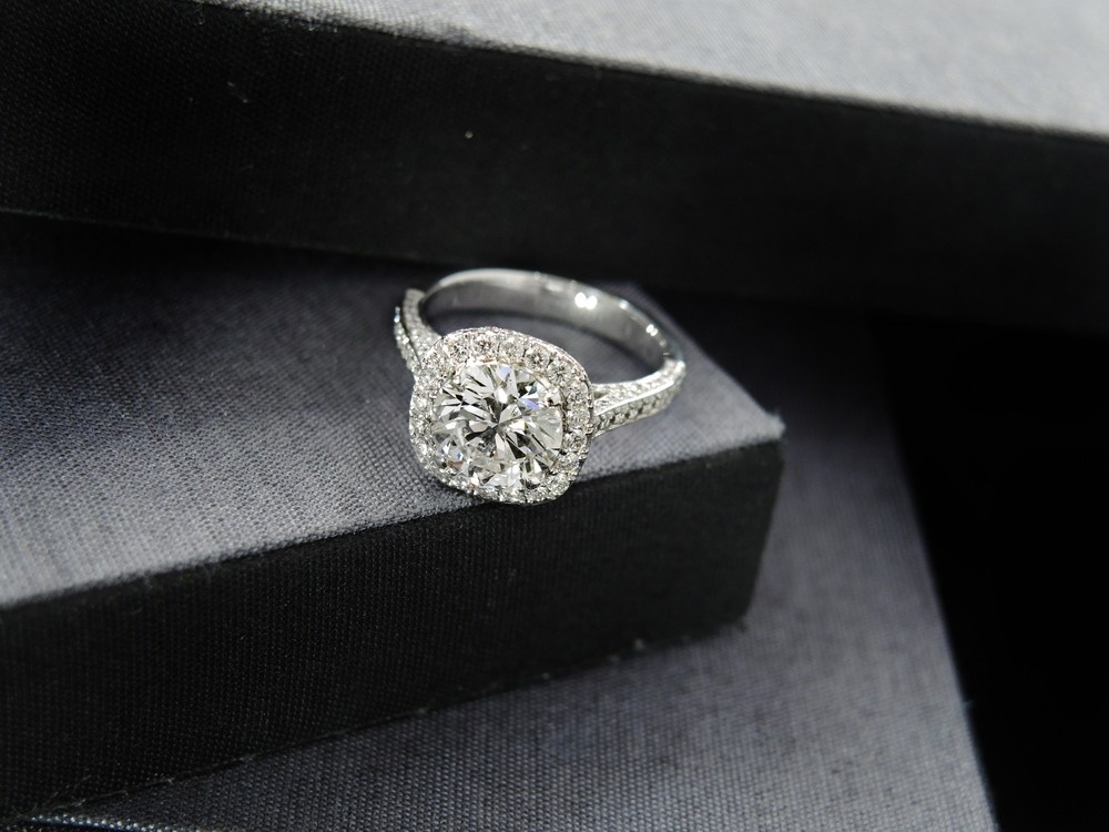 Round accent diamonds in a halo setting